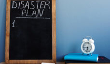 Disaster Plan written on a blackboard and notepads.