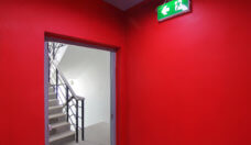Emergency exit of the building with fire exit sign and fire escape